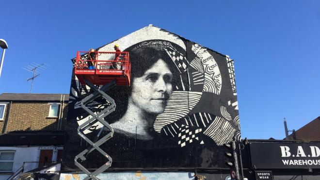 the-skyjack-6832rt-scissor-lift-being-used-to-complete-the-madge-gill-mural-in-walthamstow-london.